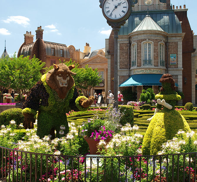 Beauty and the Beast topiary at the France pavilion in Epcot - pass the Macaron please. wwwonepennytourist.com
