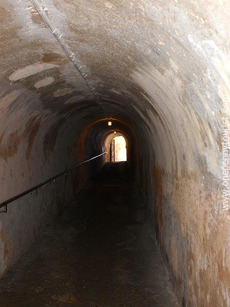Headinguphill throughthe tunnel taking you inside Castillo San Cristobal, San Juan. www.onepennytourist.com