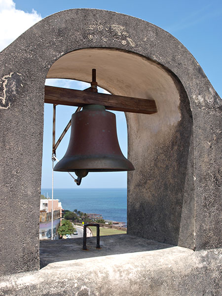 A bell high up on the ramparts of Castillo San Cristobal, San Juan. www.onepennytourist.com