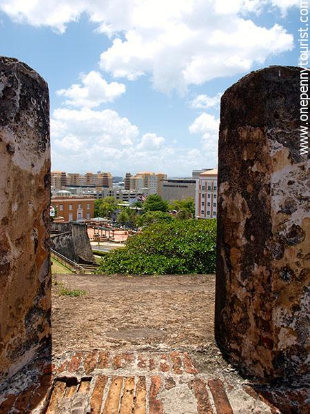 Peeking out from the ramparts at Castillo San Cristobal, San Juan. www.onepennytourist.com