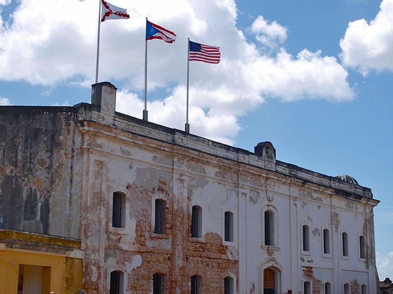 The Three Flags flying over Castillo San Cristobal, San Juan. www.onepennytourist.com