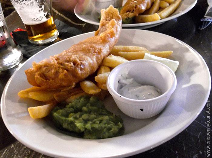 Fish, chips and mushy peas in the Dicken's Inn, London