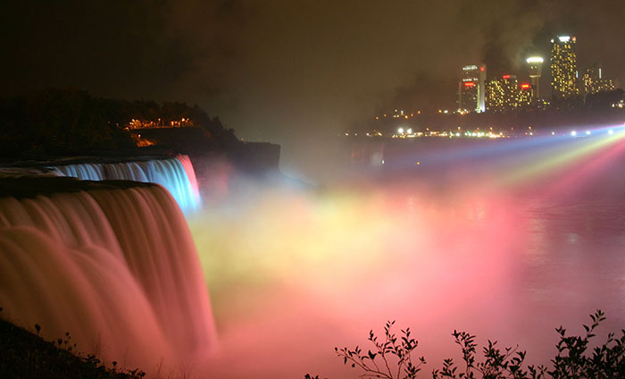 Niagara Falls lit up at night with colours