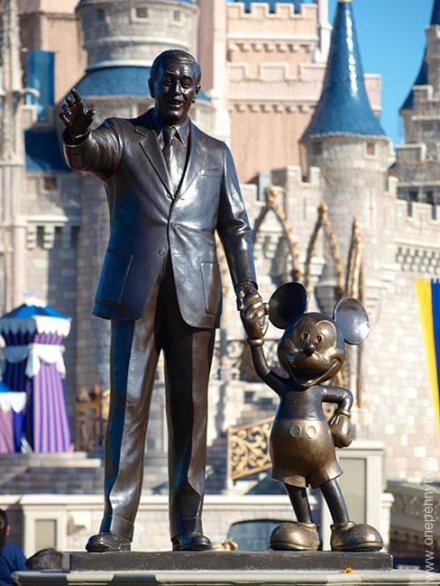 Disney Storytelling at it's finest. The Walt and Mickey Statue in from of Cinderella's Castle in the Magic Kingdom in Walt Disney World, Orlando Florida