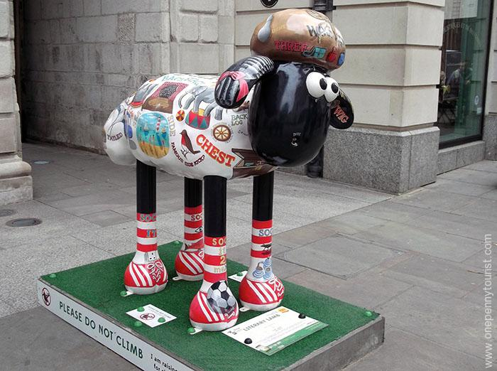 Literary Lamb Shaun is covered in words with double meanings and matching caricatures. Part of the Shaun in the City Art Trail in London.