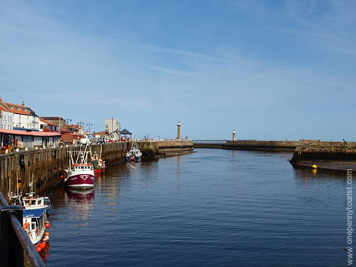 Looking out of Whitby Harbour in North Yorkshire, a great choice for your UK Seaside Bucket List. OnePennyTourist.com