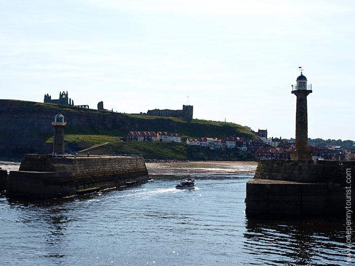 Looking back into Whitby Harbour in North Yorkshire, from the end of the sea wall