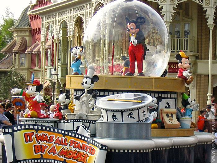 Mickey in the Share a Dream Come True Parade aka the Snow Globe Parade in the Magic Kingdom. No longer runs.