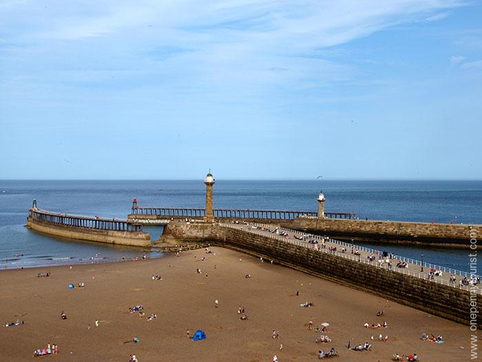 View from West Cliff of the harbour wall in Whitby, North Yorkshire