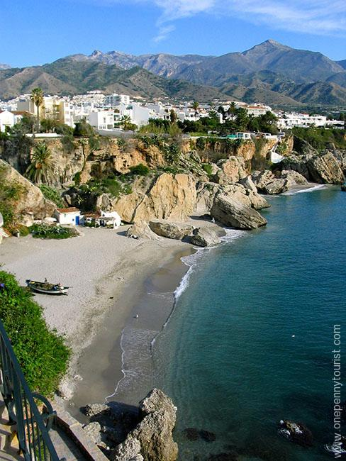 A view of a beach and the mountains from Balcon de Europa in Nerja, Spain. OnePennyTourist.com