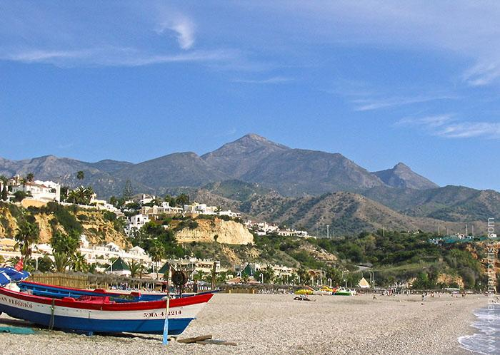 Beautiful views on the beach of the mountains in Nerja, Spain. OnePennyTourist.com