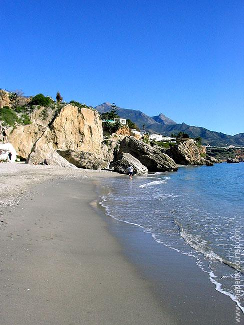 One of the cosy little beaches in Nerja, Spain. OnePennyTourist.com