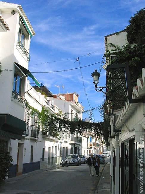 An Old Town Nerja street (Spain). Onepennytourist.com
