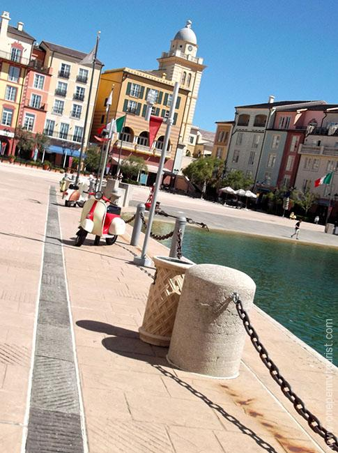 In keeping with the Italian theme of the Portofino Bay Hotel, scooters are parked by the harbour side as part of the resort decor