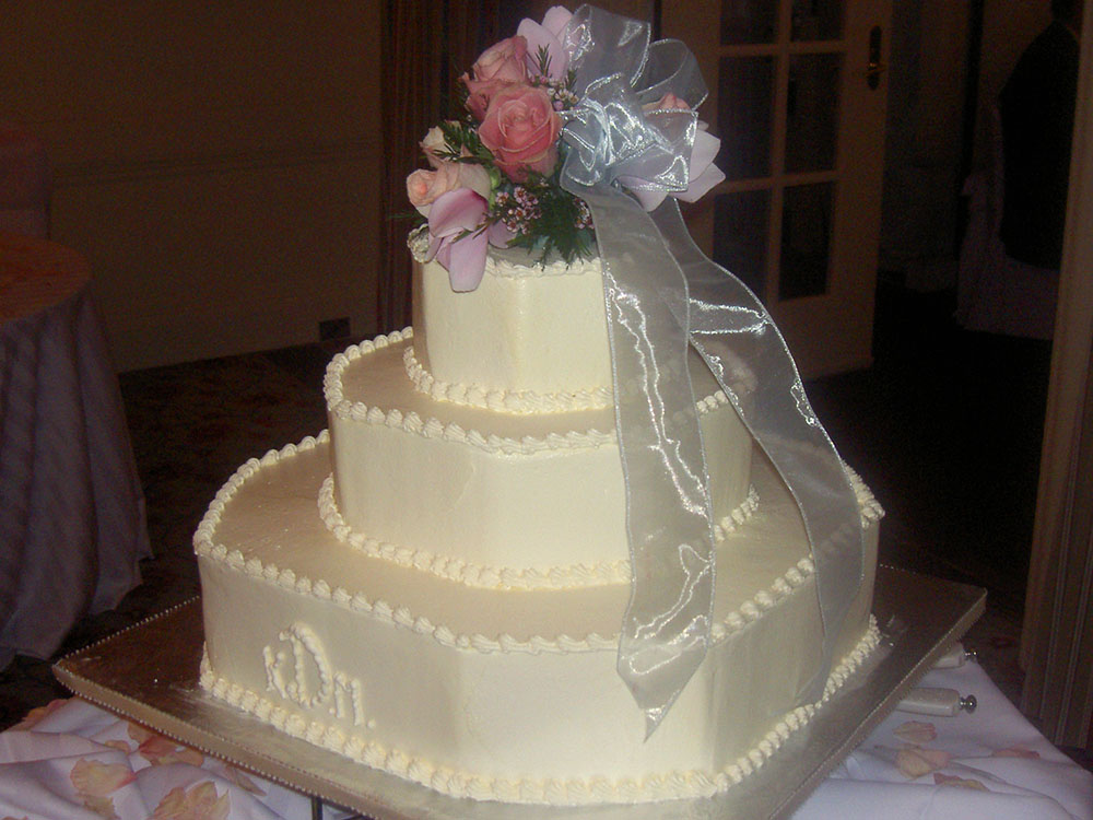 Tiered wedding cake styled on St Bride's Church steeple