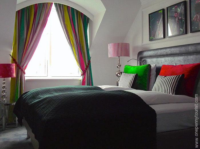 Absalon Hotel in Copenhagen - Grass themed Bedroom with pinks, greens and black decor. OnePennyTourist.com