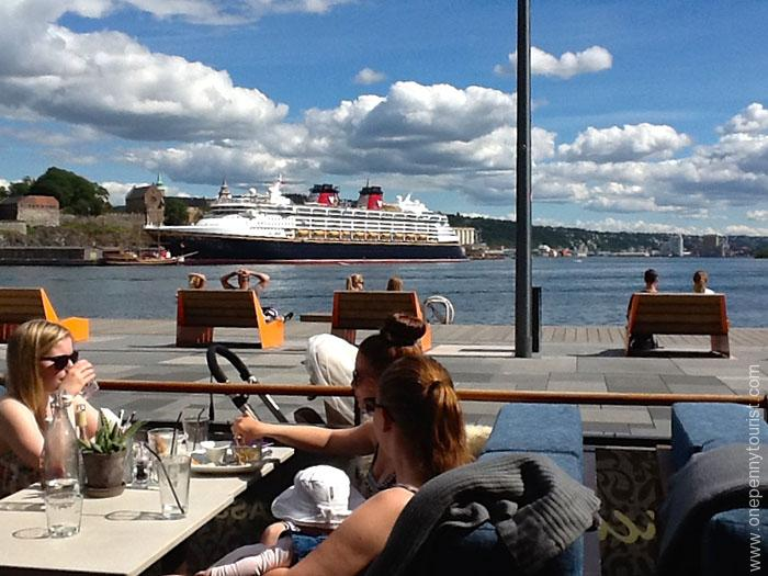 Oslo in 8 hours - Aker Brygge, Oslo, Norway - with Disney Magic in background. OnePennyTourist.com