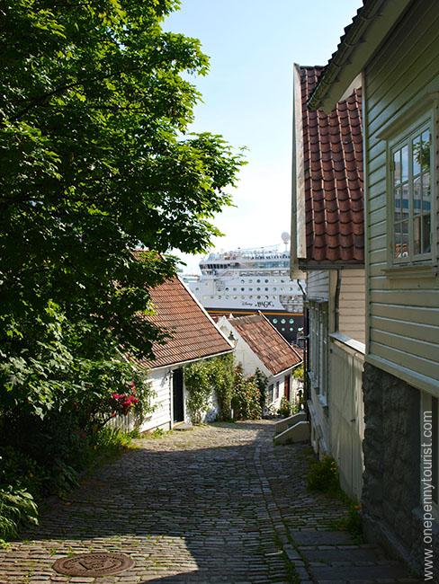 Disney Magic peeking through the buildings in Old Stavanger Norway. OnePennyTourist.com