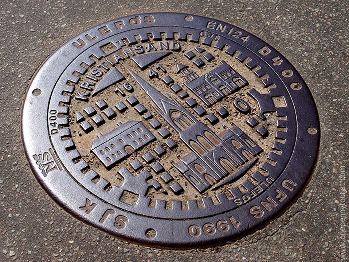 Decorated manhole cover in Kristiansand Norway. OnePennyTourist.com