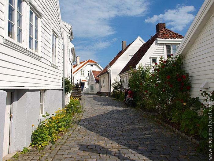 Old Stavanger street with flowers - I could have stayed taking photos all day on our visit. OnePennyTourist.com