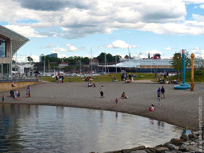 Oslo in 8 hours - Oslo Beach, Norway with Disney Magic in the background. OnePennyTourist.com