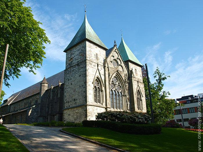 A day trip to Stavanger Norway. Imposing Stavanger Cathedral overlooking the park and lake. OnePennyTourist.com