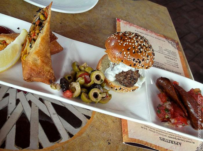 The Tingis Sampler - Harissa Chicken Roll, Lamb Slider and Moroccan Lamb Sausage. Served at Spice Road Table restaurant on Epcot's World Showcase in Walt Disney World Florida. OnePennyTourist.com