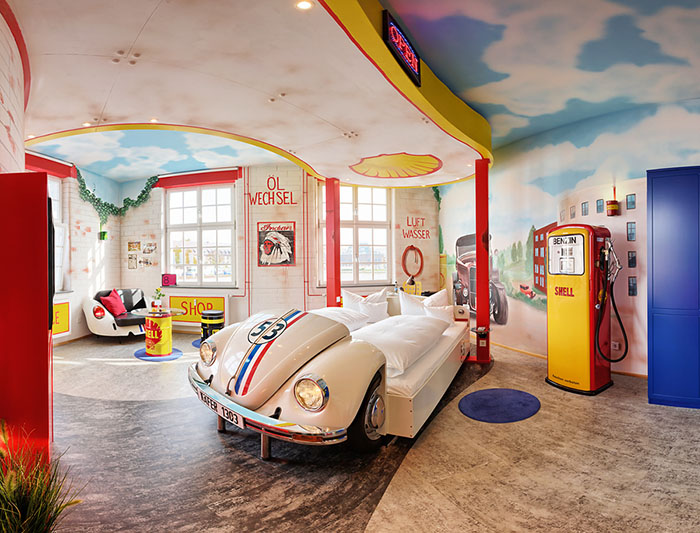 VW Beetle (Herbie!) garage bedroom at the V8 Hotel in Stuttgart, Germany. Unusual hotels around the world at OnePennyTourist.com
